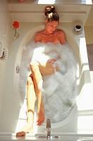 Woman lying in bath tub