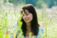 Young woman amongst wildflowers