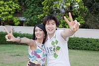 Asian couple making peace sign