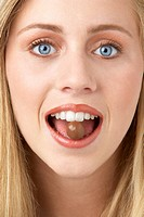 Portrait Of Young Woman Eating Chocolate