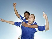 Two soccer players celebrating
