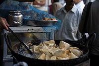 Market vendor cooking samosa