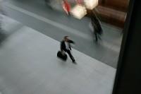 Commuter walking along platform at train station