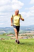 Elderly jogger training for his fitness jogging