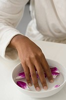 Woman with fingers in bowl