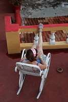 woman in rocking chair on roof terrace in Trinidad