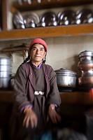 Ladakh, India, Woman sitting in her kitchen
