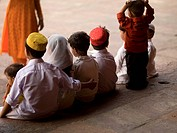 Fatehpur Sikri,Uttar Pradesh,India,Children sitting on stone steps