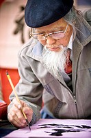 Man writing asian lettering