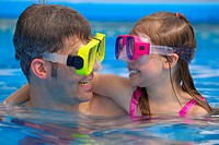 Portrait of father and daughter snorkeling