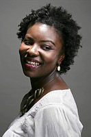 Portrait of young happy African American woman, studio shot