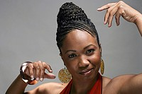 Portrait of stylish young African American woman, studio shot