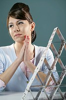 Young woman with cards placed on top of each other