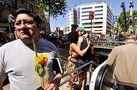 People in La Rambla, St George´s Day Catalan holiday, Barcelona. Catalonia, Spain