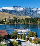 Earnslaw leaving Queenstown Bay Remarkables behind New Zealand