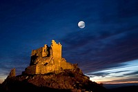 Night view of Castle Trevejo with the moon  Trevejo  Villamiel  Sierra de Gata  Caceres province  Extremadura  Spain