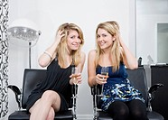 women at hairdressers with champagne