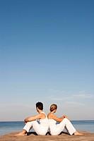 Couple Sitting On Pier
