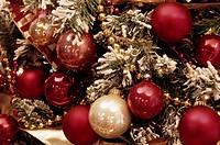 Christmas ornaments on a snowy tree