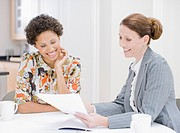 Woman reviewing paperwork with financial advisor