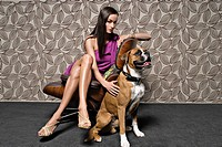 Woman sitting on chair with dog