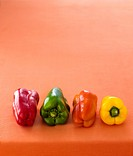 Four peppers red, green, orange, yellow