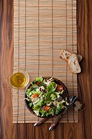 Salad with flatware and bamboo placemat