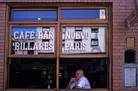 Argentina, Buenos Aires, San Telmo District, man looking out the window of Nuevo Paris cafe
