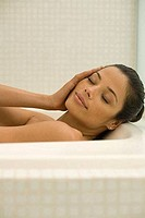 Young woman in a bathtub