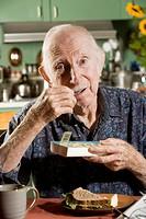 Elder Man with a Pill Case