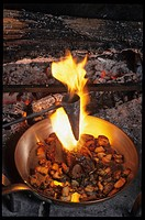 France, Landes, Parc Naturel Regional des Landes de Gascogne, Sabres, Marqueze, Sabres, Auberge des Pins, cooking of a wood pigeon with Capucin