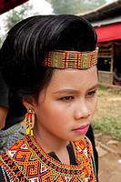 Indonesia, Sulawesi Celebes Island, Toraja land, young girl with ceremony clothes wedding or funerals