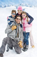 Couple with daughter and son smiling in snow