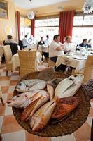 France, Bouches du Rhone, Marseille, Chez Fonfon restaurant at the Vallon des Auffes harbour, presentation of the fish for the bouillabaisse typical f...