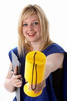 young 20 year old blonde woman wearing a blue tabard of a charity worker holding out a charity collection box smiling