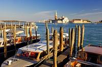 Watertaxi with San Giorgio Maggiore in background  San Giorgio Maggiore, Venice, Veneto, Italy, Europe