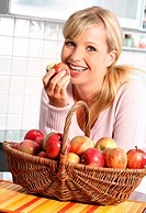 woman with basket of fresh apples