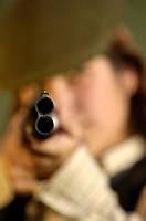Huntswoman with gun, Spain, gun barrel, shooting