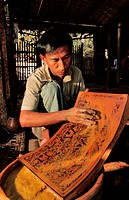 Myanmar Burma, Mandalay Division, Bagan, making lacquer, polishing