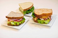 High angle view of three sandwiches