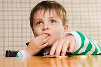 Close_up of a boy eating cookies
