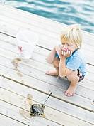 Scandinavian boy on a jetty Sweden.