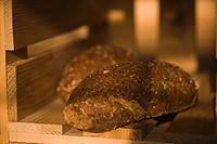 Close_up of brown breads in a crate