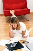 Woman worrying about home finances