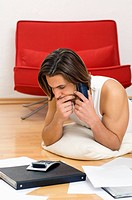 Man on phone doing home finances