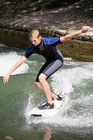 Teenage boy surfing, Munich, Bavaria, Germany