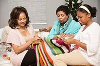 Multi_generation women knitting