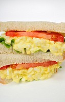 Egg salad sandwich with lettuce and tomato on white bread