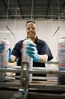 Hispanic woman working in manufacturing plant