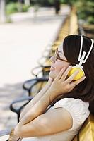 Japanese Woman Listening Music